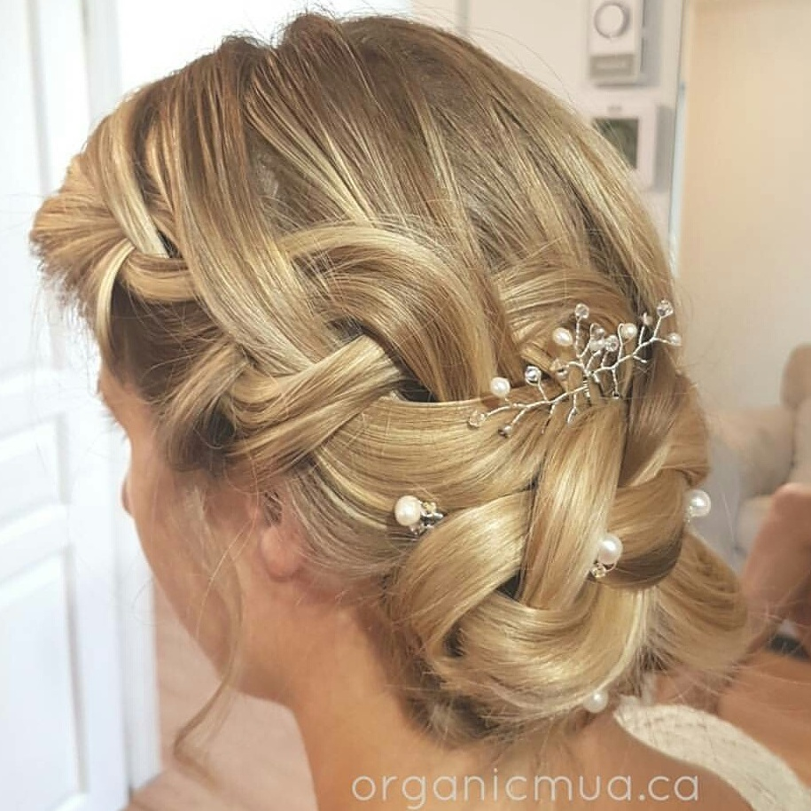 https://westcoastjewelry.ca/wp-content/uploads/2017/05/braided-updo-with-pearl-wedding-hair-pins.jpg