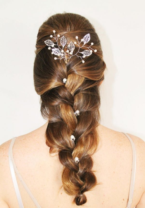 braided hairstyle with leaf hair pins