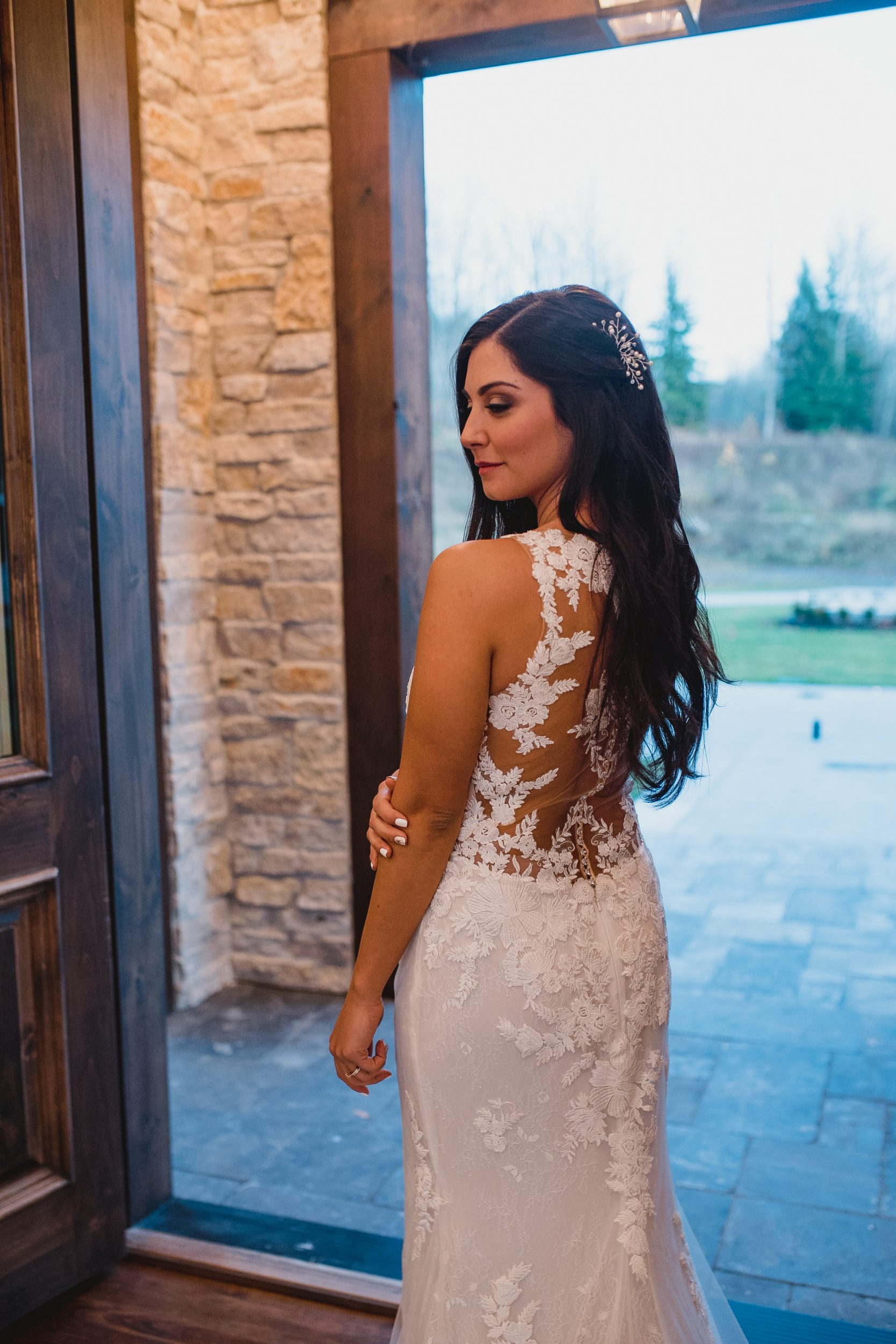 down wedding hairstyle with white hair pieces